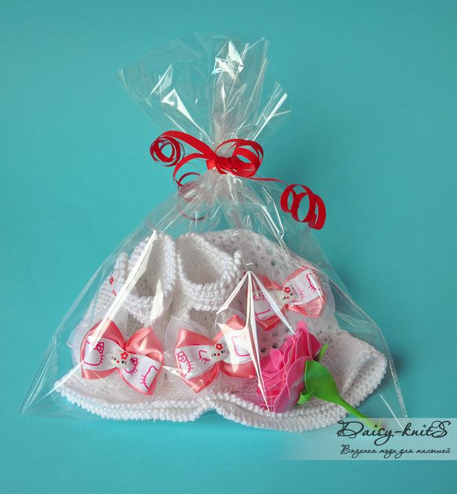 Красиво упаковываем подарок для новорожденных